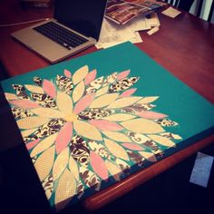 Canvas DIY Flower art. All you need - scrapbook paper, mod podge, paint, a canvas for 40% with a coupon off at a craft store!