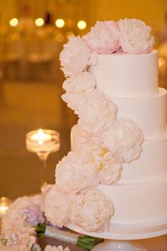 Stunning yet simple wedding cake. Event designed by @Erin McLean via@Style Me Pretty