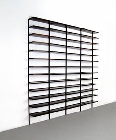 Osvaldo Borsani; #E22 Enameled Aluminum and Rosewood Shelves for Tecno, c1960.