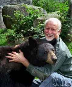Lynn Rogers - hugging - Gerry, a wild bear. He has studying bears over 42 years