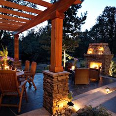 Spaces Pergola Design, Pictures, Remodel, Decor and Ideas - page 15 - really like the stone at the base of the wood beams, but with thicker beams.  lighting on the ground is pretty too