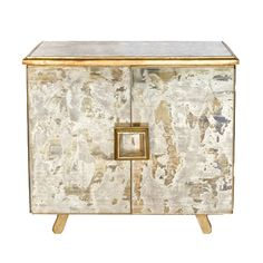 Reverse antique mirror and gold leaf 2 door chest. One fixed interior shelf. Back painted gold.