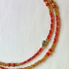 #waistbeads Thunder & Honey -  Single Strand: Honey & Amber w/Two shades and sizes of red seed beads with metal accents. #keffigal #rootsnculture $20