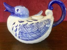 Bombay Imports blue and white ceramic teapot! The teapot is in great condition with no cracks or chips! Nice shiny glaze on this ceramic teapot! It stands about 6 inches tall and is about 9 inches wide handle to spout! Beautiful floral and feather blue designs! Cute teapot for