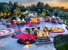 FULLY LOADED heated swimming pool with a hot-tub, lazy river, waterslide, island, bridge, infinity edge, cave, sunk in fire pit, waterfalls, AND customizable LED lighting  ... Tag someone that would die over this! #ModernMansions