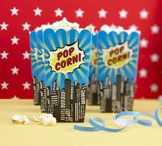 Superhero popcorn boxes. Would be a very easy thing to use regular popcorn boxes, design this in photoshop, print onto card stock and attach to popcorn boxes.