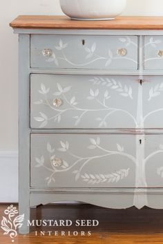 A simple, hand painted tree across the drawers and some glass knobs that will just disappear in the design, but add a little sparkle, and some very light sanding around the edges and keyholes | miss mustard seed