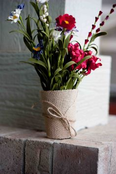 Beautiful bouquet of flowers in a mason jar wrapped in burlap and twine. Love!