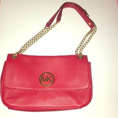 Michael Kors Leather Shoulder Bag ❤️ AUTHENTIC MICHAEL KORS Red Leather Shoulder Bag. Retail Value of $298.00 plus tax! Only used twice- in excellent condition. Interior has 1 zipper enclosure, 1 side pocket, and 6 credit card slots. The straps of the purse can be held together as two or worn on the shoulder as one long strap. Gold fixtures Michael Kors Bags Shoulder Bags