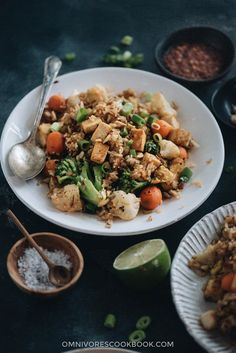 This easy tofu fried rice is a healthy and delicious one-pot meal that you can whip up in 20 minutes. It is bursting with flavor and loaded with vegetables.