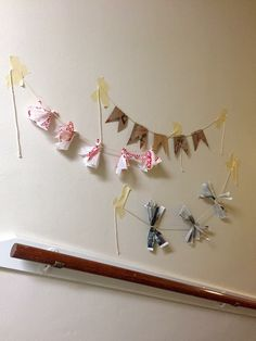 For all the decorations I created for March's Recyclemania theme, I used recycled materials (specifically Trader Joe's bags, Target bags, and newspaper.). I made about 30 garlands which were placed all along the hallway on my floor.