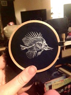 Tiny fish skeleton embroidery. By Lillian Ripley