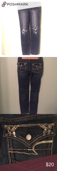 American Eagle Skinny Jeans Classic skinny jeans. Destruction at knees. Super cute flap pocket detailing. American Eagle Outfitters Jeans Skinny