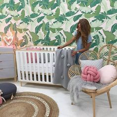 I N S P I R E // We adore @redsbabyaus tropical nursery styled to perfection by the gorgeous @littlelibertyrooms . Backdrop 'Palm' wallpaper @pickawall // Chair: @thefamilylovetree // Cushion: @designstuff_group // Throw: @kipandco Reposted Via @pickawall