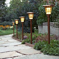 Outdoor lighting is an easy way to boost curb appeal. More ways to add curb appeal: http://www.bhg.com/home-improvement/exteriors/curb-appeal/ways-to-add-curb-appeal/?socsrc=bhgpin062413lighitng=4
