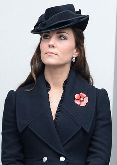 At the Remembrance Sunday ceremonies at the Cenotaph in Whitehall, London, wearing black Alexander McQueen black flared wool coat & black Jane Corbett hat - November 9th, 2014.-