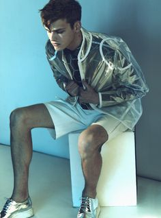 I think I would wear a see through gold reflective jacket. Very space age. I love space age.