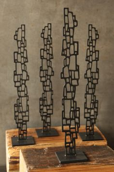 Artist and author Susie Frazier designs wall art, furniture, and home decor that calms the mind through the use of earth materials, natural patterns and weathered textures.