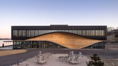 3XN and SLA have completed a climate centre in Lemvig, Denmark, featuring a wavy wooden facade influenced by the port town's boat-building history. Boat Building, Building Design, Elephant World, Wooden Facade, Water Playground, Timber Slats, Timber Structure, Sustainable Architecture, Cultural Architecture
