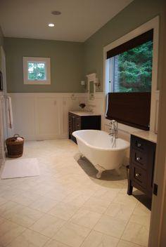 american olean catarina colesium white tile, dark wood vanity, white wainscoting, light blue walls