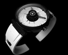 10 of the Hottest High-End Car-Inspired Watches - The watch version of a three-point-badged Mercedes grille, the Silver Arrow concept was designed by French designer Faibein Cacheux in recognition of the gull-winged SLS AMG that Mercedes introduced last year. In a James-Bond-worthy twist, the watch includes remote entry buttons to pop open those gullwings and let yourself inside