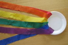 A simple and fun activity to create your very own rainbow. We used a small paper plate with each colour of the rainbow streamer attached with sticky tape. My kids loved playing and dancing with them. #Rainbowcraftactivities #rainbowactivities