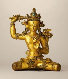 Lot A superbly cast gilt-copper stone-inlaid seated figure of Manjusri, Nepal, century; Buddha, Oriental, Buddhist Philosophy, Tibetan Art, Bronze, Crown, Buddhist Art, Turquoise, 14th Century