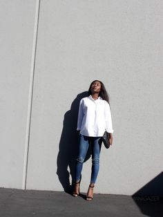 Minimal style | How to wear the white button down shirt casually while keeping it chic. Featuring Zara distressed skinny jeans, heeled sandals and holographic clutch, and Asos shirt.