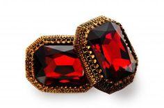 Elegant and striking Swarovski crystal, burgundy-coloured, in artistic setting of bronze.  http://mysfashion.com