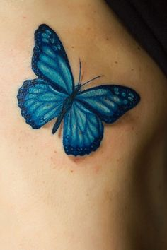 Small Blue Butterfly Tattoo On The Left Shoulder Blade Tattoo