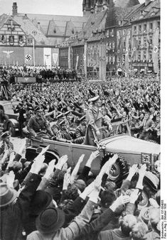 Hitler rides triumphant into the Sudetenland, part of Czechoslovakia that has just been dissolved by the Nazis, 1938.