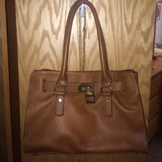 Kelly&Katie cognac purse Originally bought at dsw, perfect condition although it's been used many times. Very durable. Selling because I got a new purse no need for 2 Kelly & Katie Bags Shoulder Bags