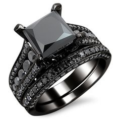 Step out of the ordinary with this stunning certified black diamond ring crafted from silky looking 14 karat black gold and a total of 3.8 carats of black diamonds. Dark and seductive, the set include