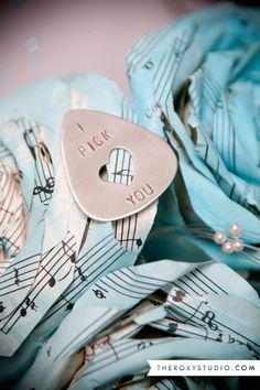 Photography by Samantha McGranahan, The Roxy Studio. Wedding photography, wedding, bride, groom, blue wedding, music notes, guitar pick, music wedding, paper flowers, paper rose