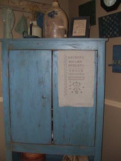 Blue cupboard to hide our TV, my husband made for us.  Love those blues.