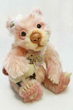 """Annabelle by Waynestonbears - 9½"""" (24cm). Made from a pattern by Joanne Livingston. She is made from soft pink & tan mohair & is handcrafted by Wayne Lim of Singapore. Her face is needle sculpted & needle felted with wool. She has German glass eyes & 4-way jointed limbs. Her nose is needle felted, sealed, sanded & painted. Paw pads are made of ultra-suede with needle sculpted techniques. She is filled with polyfill, crushed garnets, & glass beads. Annabelle wears lace & has a lamb soft toy"""