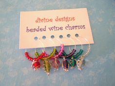 These fun and unique little wine charms feature pretty transparent glass seed beads with larger wire wrapped glass charms. This set features pink, Wine Bottle Charms, Bottle Jewelry, Cork Crafts, Bead Crafts, Wine Ring, Wine Glass Markers, Craft Show Displays, Painted Wine Glasses, Wine Gifts