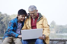 Boy and his grandfather using a laptop at lakeside and smiling Things To Come, Laptop, India, Stock Photos, Couple Photos, Image, Couple Pics, Delhi India, Couple Photography