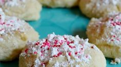 These soft Italian-style cookies are a hit with everyone. The ricotta  keeps them moist, and the recipe yields a large batch, which is great  since the baked cookies freeze so well. Do not freeze the unbaked  dough.  You can decorate them with chopped candied cherries, colored sugar or candy sprinkles.