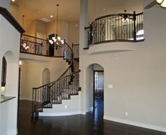 Brentwood First Texas Homes Juliette Balcony Entry Stairs, House Stairs, Texas Homes, New Homes, Juliette Balcony, Elegant Living Room, Grand Homes, Stair Railing, Home Photo