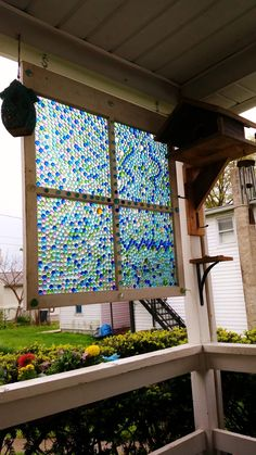 Garden art made of old window and glass beads