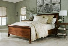 I like the colors of the wood floor and sleigh bed with the greens and golds (though the room looks like it's missing something, like crown molding)