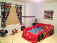 """Toddler bedroom decorated as Disney's """"Cars""""."""