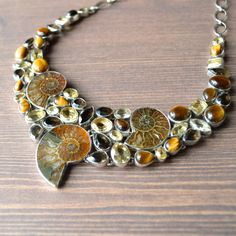 Fossil Ammonite & Stone Cluster Necklace - Gorgeous Ammonites from Morocco are delicately paired with smoky quartz, citrine, and Tiger's Eye cabochons set in sterling silver. Elegant and opulent!