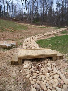 River Rock Creek Bed with wooden step bridge.  Dahlonega, GA