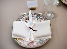 vintage china with cutlery tied with ribbon