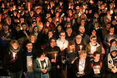 New Zealand:Members of the public look on during a candlelight vigil at Frank Kitts Park  in Wellington, New Zealand