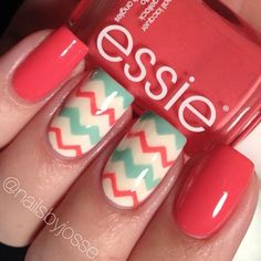 Coral, white, and mint chevron nails
