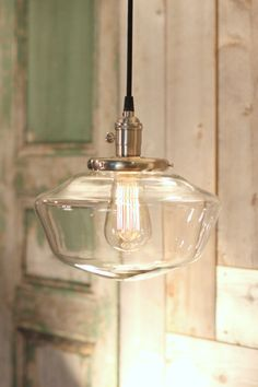 I love this clear schoolhouse shade.  Classic lines that can fit anywhere.  See…