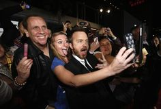 """Aaron Paul poses with some fans at the premiere of the film """"Need for Speed"""" at the TCL Chinese theatre in Hollywood, March 6, 2014. REUTERS/Mario Anzuoni"""